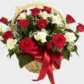 2 dozen mixed white and red roses in basket